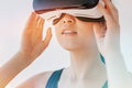 Woman using the virtual reality headset and looking away