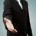 successful business man, gesturing handshake