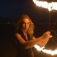 Young Blonde Woman With Flaming Torches