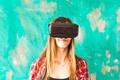 Young Woman Wearing Virtual Reality Headset