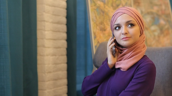 Download Young Muslim Girl Uses Smartphone nulled download