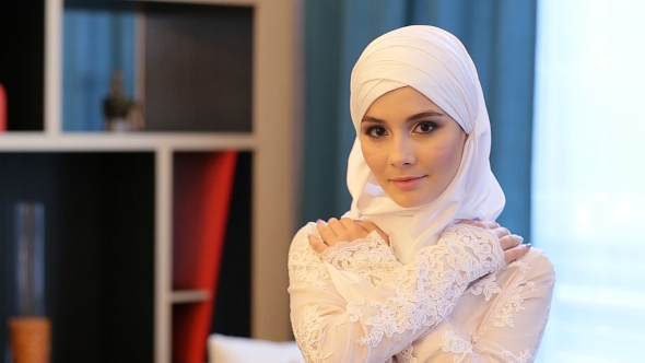 Download Young Muslim Girl Looking at the Camera nulled download