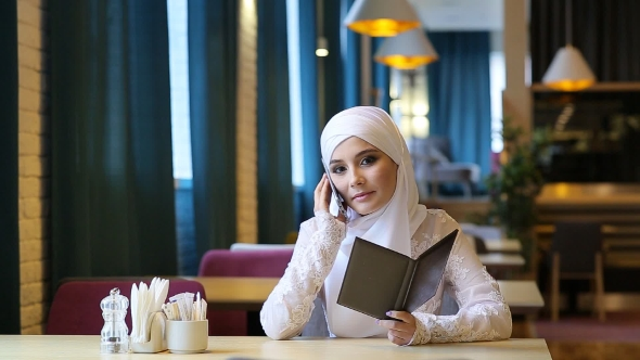 Download Young Muslim Girl in Cafe nulled download