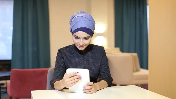 Download Muslim Girl Student Uses Tablet nulled download