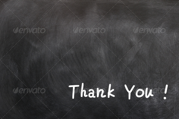Thank you - written with chalk on a blackboard - Stock Photo - Images