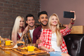 People Group Eating Fast Food Burgers Potato Sitting At Wooden Table In Cafe Taking Selfie Photo