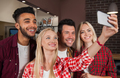 People Friends Taking Selfie Photo At Bar Counter, Mix Race Man Woman Hold Smart Phone