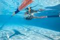 Woman swims underwater