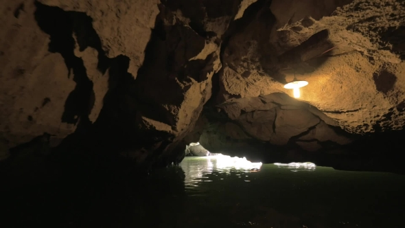 Download Sailing Through The Cave In Ha Long Bay, Vietnam nulled download