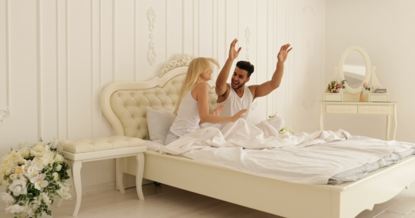 Download Couple Sitting in Bed and Dancing  nulled download