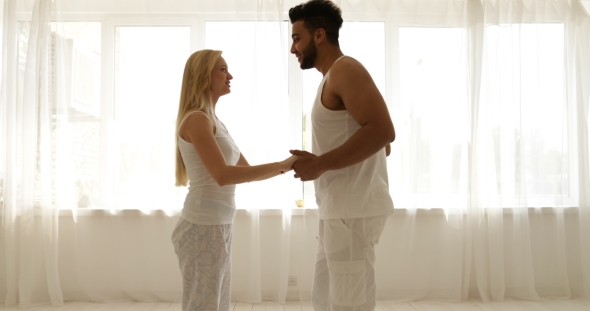 Download Couple Love Embrace Walking To Window Open Curtains Mix Race Man Woman Rear View Hug Morning Bedroom nulled download