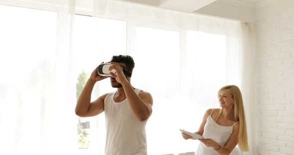 Download Man Using Virtual Reality Glasses Woman Holding Digital Tablet Computer 3d Technology Concept, Mix nulled download