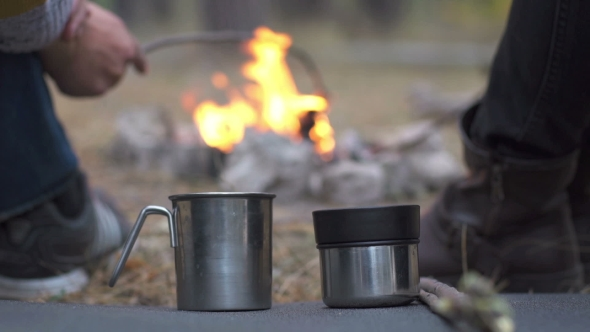 Download Group Of People Having a Party Outdoors And Cooking Meat On Campfire nulled download
