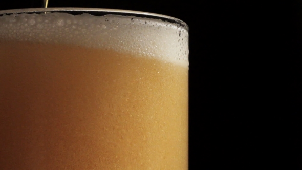 Download Beer Is Poured Into a Glass nulled download