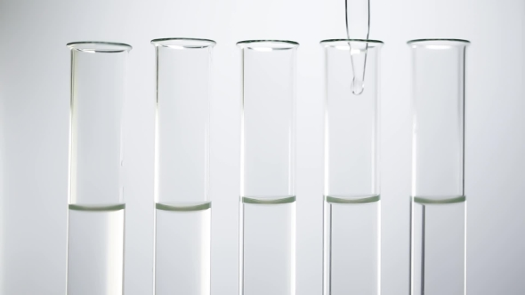 Download A Pipette Drips Transparent Water Into a Test Tubes nulled download