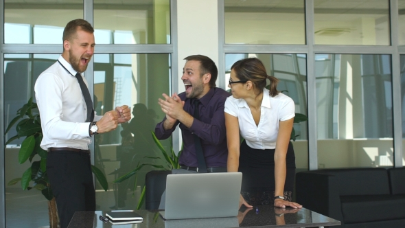 Download Happy Business Team Celebrating Victory In Office nulled download