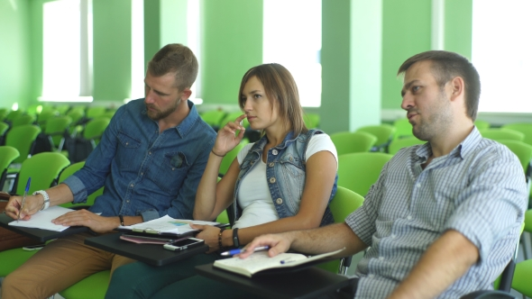 Download Three Students Sitting At The Lecture nulled download