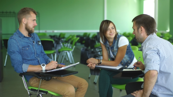 Download a Group Of Students Sitting At The Lecture In The Classroom nulled download