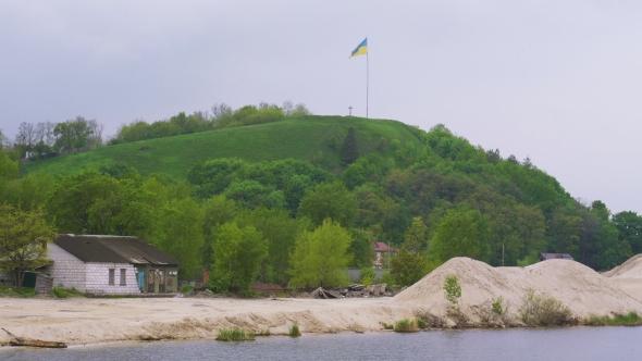 Download Ukrainian Flag Fluttering Over Devich Mountain In Trypillia Village, Ukraine nulled download