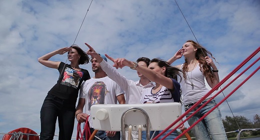 Young people relaxing on a yacht
