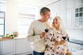 Vivacious healthy elderly couple drinking wine
