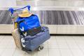 Luggage near baggage band at airport