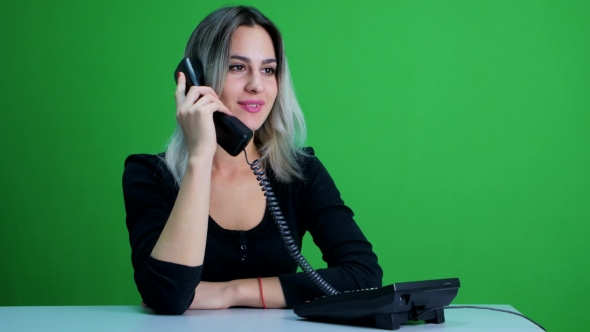 Download Cute Girl In An Office Talking On The Phone With a Client. Green Screen Studio nulled download