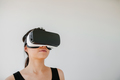 Young woman wearing VR goggles