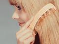 Closeup girl combing her long hair