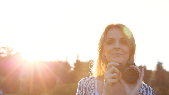 Download Beautiful Young Female Photographer Taking Pictures nulled download