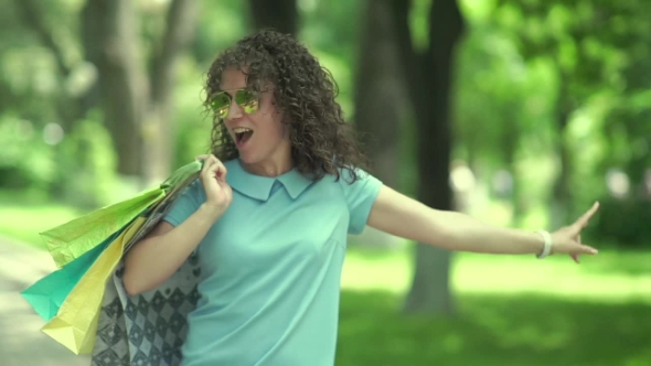 Download Curly Girl Dancing And Jumping In The Park. nulled download