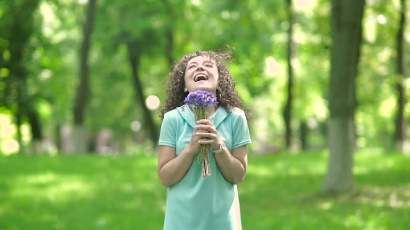 Download Girl Smelling a Bouquet Of Flowers. nulled download