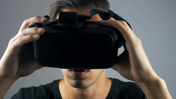 Download Shot Of Man Getting Experience In Using VR-headset. nulled download