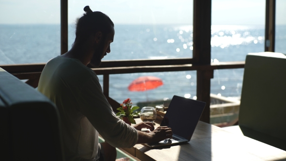 Download Young Freelancer Working On The Background Of The Sea nulled download