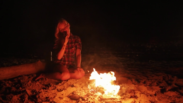 Download Girl Vaping By Camp Fire At Night nulled download