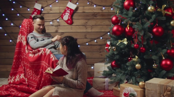 Download Happy Couple Having Fun At Home At Xmas Eve nulled download