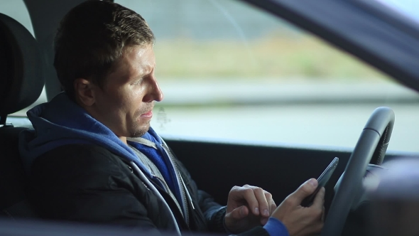 Download Man Sits In Car Holding Tablet With GPS Navigator nulled download