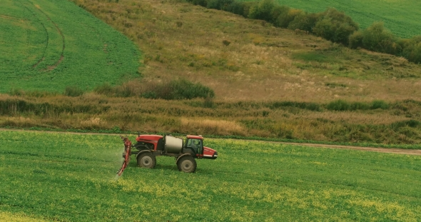 Download Tractor In a Field Of Rapeseed Processing nulled download