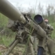 Camouflage Sniper Rifle Is On The Ground In The Grass. Airsoft Guns
