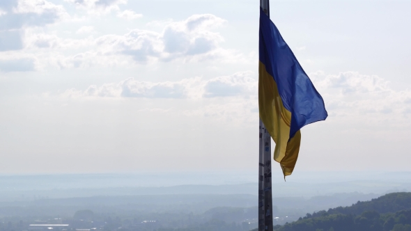 Download Ukrainian Flag Flying On Top Of The Beautiful Panorama Of The City Lviv nulled download