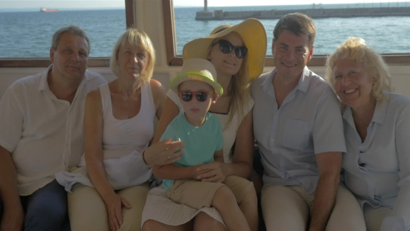 Download Happy Family Child Mother Father Grandparents Are Sitting On Closed Deck Of Boat nulled download