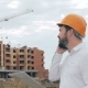 Architect Talking On Cell Phone On a Construction Site