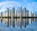 skyscraper skyline reflected on water - PhotoDune Item for Sale