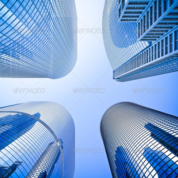 blue highrise glass skyscraper intersection low angle shot - Stock Photo - Images