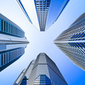 blue highrise glass skyscraper intersection low angle shot - PhotoDune Item for Sale