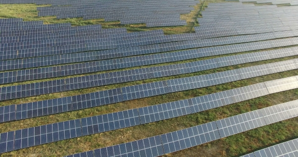 Download Aerial View. Flying Over The Solar Power Plant With Sun. Solar Panels And Sun. Aerial Drone Shot nulled download