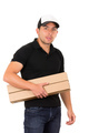 friendly confident delivery man carrying boxes
