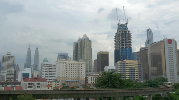 Download View Of Train On The Foreground And Modern Buildings Skyscraper On The Background. Kuala Lumpur nulled download