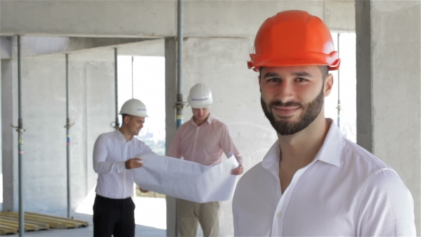 Download Construction Engineer Poses At The Building Under Construction nulled download