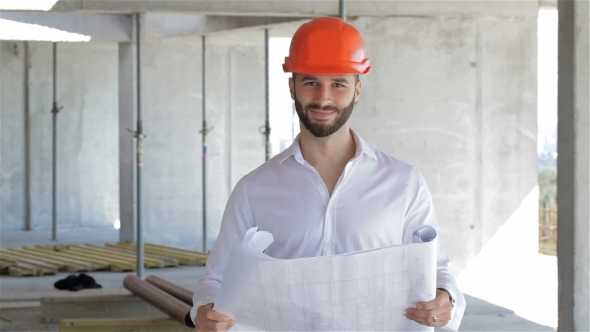 Download Construction Engineer Walks Through The Building Under Construction nulled download